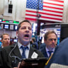 Wall Street rises as banks and health care companies climb, but tech stumbles