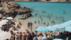 Tourists at Blue Lagoon in Comio, Malta. As European economies open for the tourist season, there are concerns about the deltas wave.