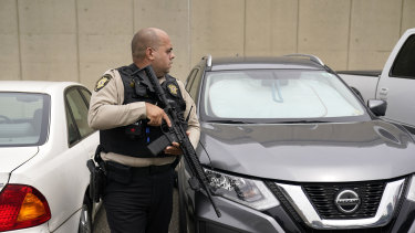 Police officers search the scene after an officer was stabbed outside the pentagon on Tuesday.