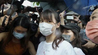 Agnes Chow, centre, was released on Saturday after serving seven months of a 10-month sentence.