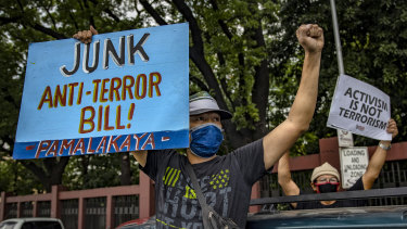 People protest the anti-terror bill outside the Philippine Congress, despite a ban on public gatherings due to the coronavirus outbreak.