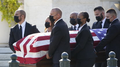 Mourners pay respects to Ruth Bader Ginsburg at US Supreme Court