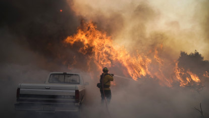 Wildfires prompt evacuation of 100,000 from Los Angeles area