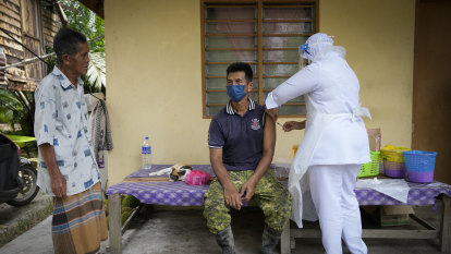Crushed by COVID, Malaysia now has one of the world's fastest vaccination rates