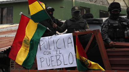 Police abandon posts outside Bolivia's presidential palace in ominous sign for Morales