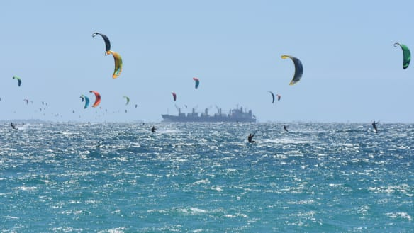 Record smashed as kiteboarders ride the wind across Gage Roads