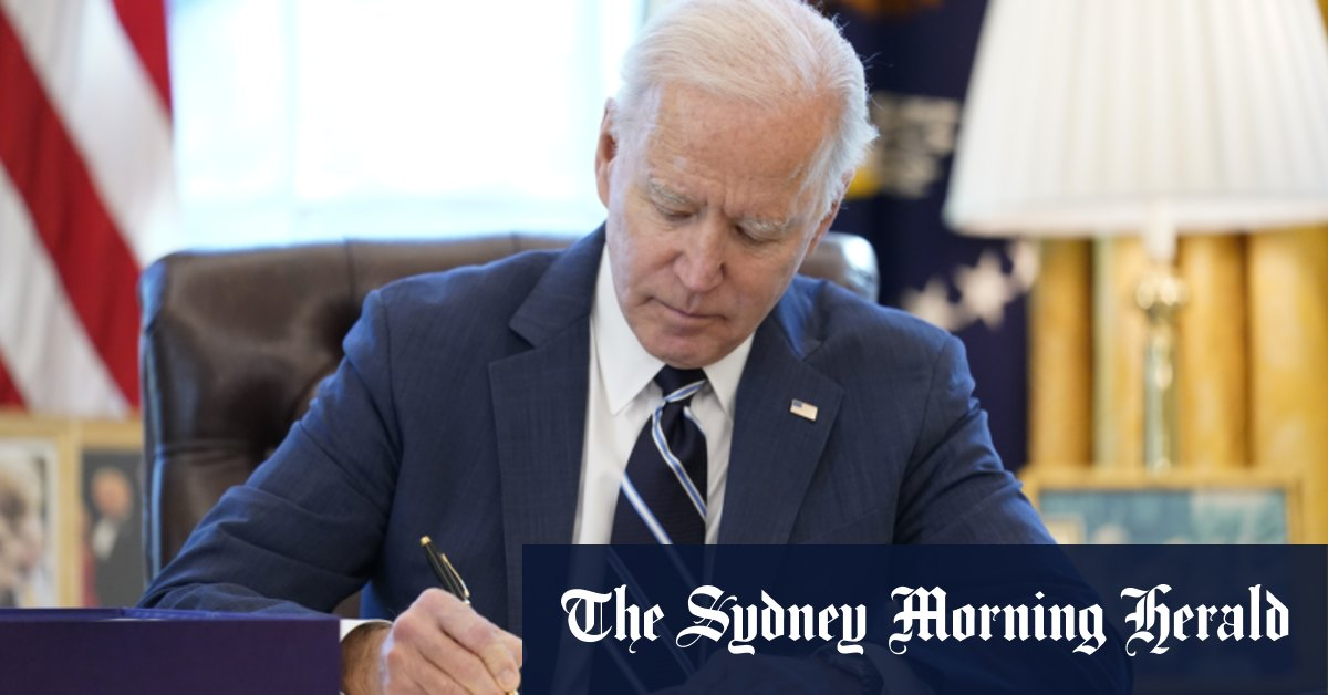 Biden signs $US1.9 trillion stimulus into law to rebuild 'the backbone of this country'