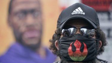 A protester marches at a rally, Monday, April 19, 2021, in Minneapolis.