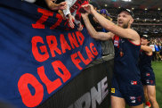Max Gawn celebrates with the Melbourne faithful after the Demons' grand final win in Perth.