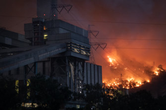"""Fires burn at the back of a thermal power plant in Turkey, where the disaster has also become a political issue. President Erdogan accused opposition party members of a """"terror of lies"""" for criticising the lack of aerial firefighting."""