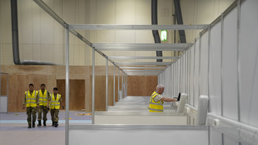 The UK military and contractors build an initial 500 beds at the NHS Nightingale Hospital at London's ExCel Centre.