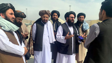 Taliban officials are interviewed by journalists inside the Hamid Karzai International Airport earlier this week.