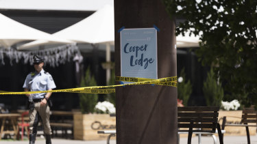 Cooper Lodge at the University of Canberra is evacuated and cordoned off by police