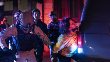 A protester is arrested in Portland.
