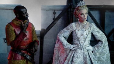 Michelle Pfeiffer as Queen Ingrith and David Gyasi as Percival in Maleficent: Mistress of Evil.