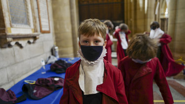 Young choristers wear masks as they prepare for the the Good Friday morning choral service, which took place without members of the public present due to Covid-19 regulations, at Truro Cathedral in Truro, England.