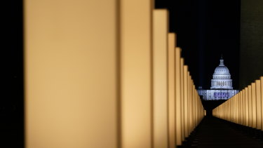 Lights surround the Lincoln Memorial Reflecting Pool, placed as a memorial to COVID-19 victims in Washington.