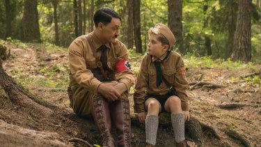 Taika Waititi and Roman Griffin Davis in the film Jojo Rabbit.