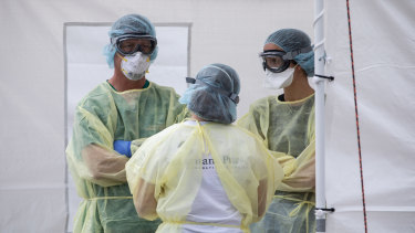 Medical workers near Milan in northern Italy prepare to treat more patients.