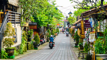 Tourists strolling along the central street of Ubud.