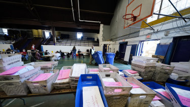 Election workers process mail-in and absentee ballots at West Chester University, Pennsylvania.