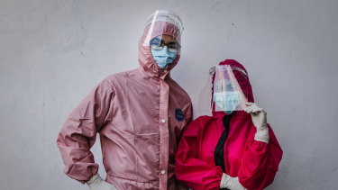 Drs Yohanes Ridora, left, and Nabila Kirtti pose during a virtual fashion show of personal protective equipment (PPE) in Yogyakarta, Indonesia. The fashion show was held as a form of gratitude for medical personnel.