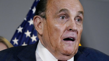 Hair dye runs down the face of Donald Trump's personal lawyer Rudy Guiliani  during a press conference in November.