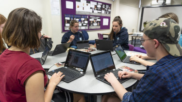 Alfred Deakin High School students Jessica Booth (left) Catriona Cochrane, Catherine Smith and Sabrina Allan using Chromebooks at school