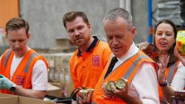 Federal Opposition Leader Bill Shorten helps pack boxes at Foodbank in Melbourne this week.