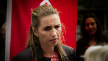 Mette Frederiksen, leader of The Social Democrat party, talks to a voter ahead of the poll.