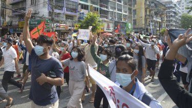 Anti-coup protesters flash the three-finger salute of defiance during a demonstration in Yangon.