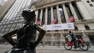 The New York Stock Exchange and Fearless Girl, a bronze sculpture by Kristen Visbal in New York.