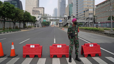 Military and police are being deployed to enforce movement restrictions in Jakarta.