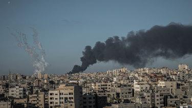 Cross-border air war: a fire north of Gaza City, along with rockets shot from from Gaza toward Israel.