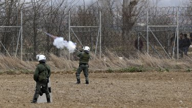 Greek riot police fire tear gas at migrants who try to enter Greece from Turkey at the Greek-Turkish border in Kastanies on Wednesday.