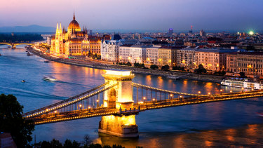 The beautiful cities of Buda and Pest, with Margaret Island in the background.