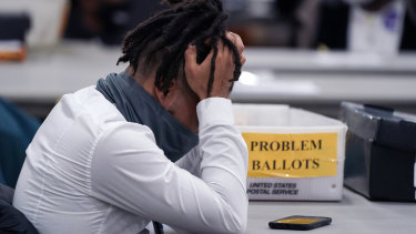 An elections worker put his head in his hands in the final hours of counting on Wednesday night in Detroit.