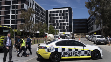 Police cars and ambulances outside Cooper Lodge at the University of Canberra on Wednesday,