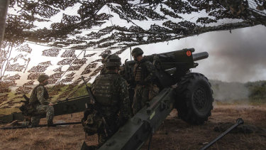 Taiwan's military undertake drills that simulate an attack by China.