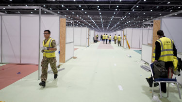 The military and contractors build the NHS Nightingale Hospital at the ExCel Centre in London for COVID-19 patients.