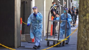 Staff in protective gear at the Holiday Inn in Flinders Lane on Tuesday.