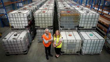David Barry Logistics operations director Stephen Campbell and CEO Sonya Constantine in front of toxic waste sent to their storage facility by Bradbury Industrial Services.