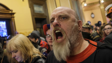 A protester shouts during the demonstration.