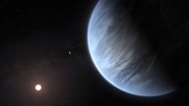 An artist's rendering shows Exoplanet K2-18b, foreground, its host star and an accompanying planet in this system.