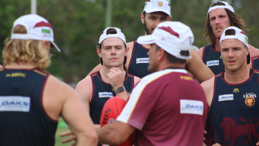 Neale and his teammates receive instruction at training.