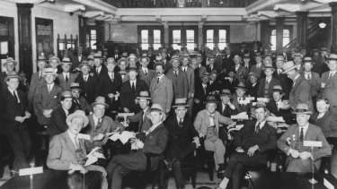 The gender of members at the Tattersalls Clubhas remained unchanged since its founding. Pictured is Settling day at the club for bookmakers and clients in 1926.