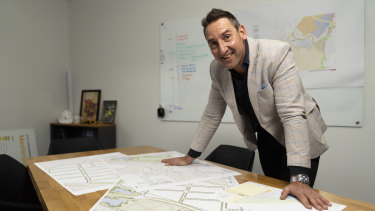 Village Building Company chief executive Travis Doherty with the master plans for the South Jerrabomerra Estate.