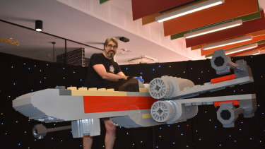 """""""Master Builder"""" Mark Curnow has assembled the largest LEGO X-Wing in Australia at Dreamworld."""