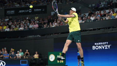 John Millman in action against Michail Pervolarakis in Brisbane on Tuesday night.