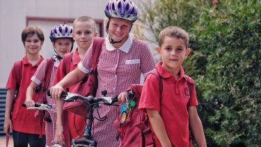 Sam, 7, Claire, 9, David, 11, Chantelle, 10 and Connor, 11, try to walk or ride to school as often as possible.